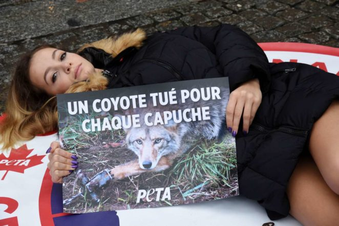 Cassandra Foret - With PeTA Animal rights activists protest against Canada Goose Company in Paris