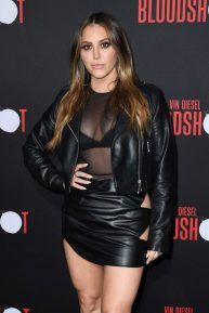 Cassie Scerbo wearing black leather mini skirt at 'Bloodshot' Los Angeles premiere
