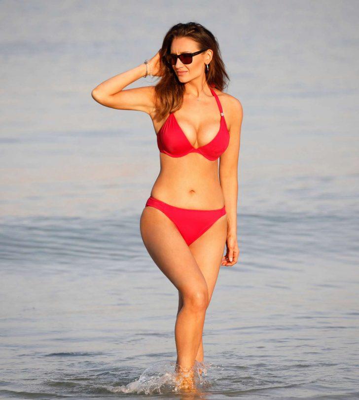 Catherine Tyldesley in Red Bikini on the beach in Dubai
