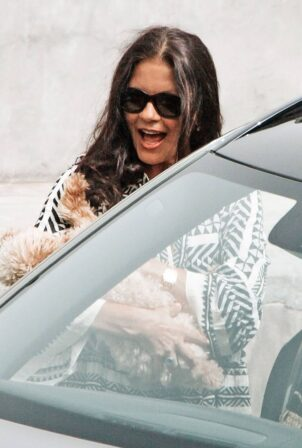 Catherine Zeta-Jones - Seen as she picks up her excitable pet pooch out in Mallorca