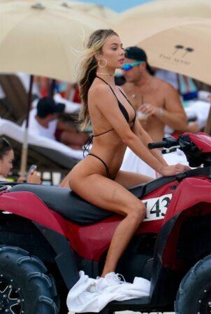 Celeste Bright - in a black bikini at the beach in Miami
