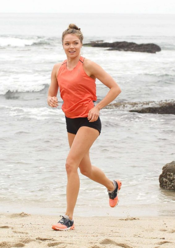 Chari Hawkins in Shorts - Jogging on the beach in San Diego