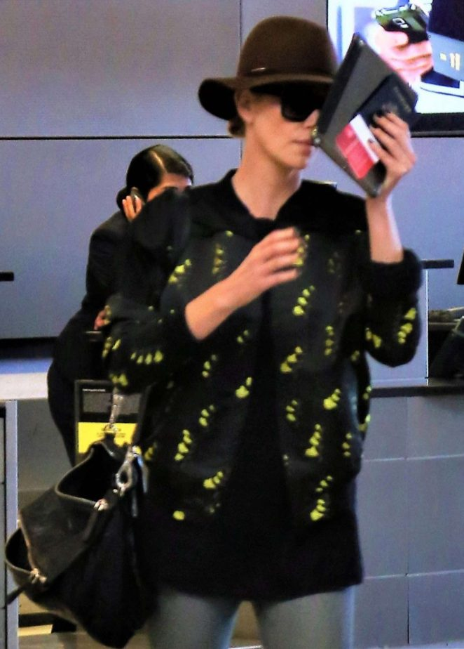 Charlize Theron - Arriving at LAX Airport in Los Angeles