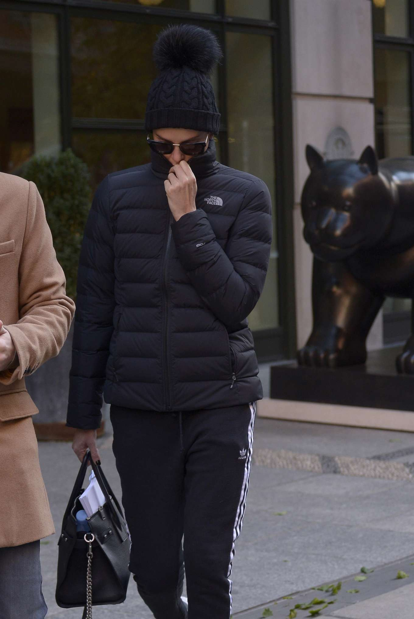 Charlize Theron - Exiting her hotel in New York
