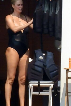 Charlize Theron - In a black swimsuit in Greece