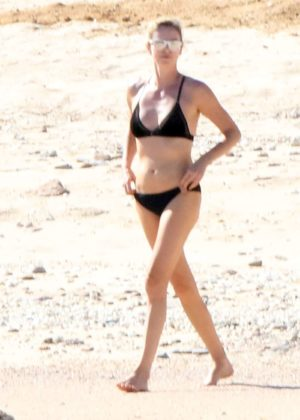 Charlize Theron in Black Bikini on the beach in Los Cabos