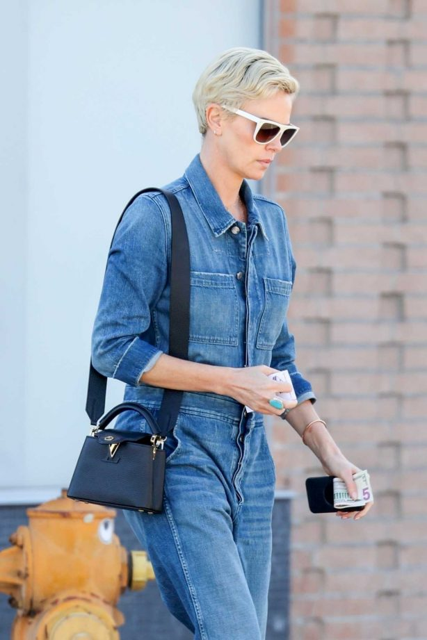 Charlize Theron - In denim jumpsuit out in Los Angeles
