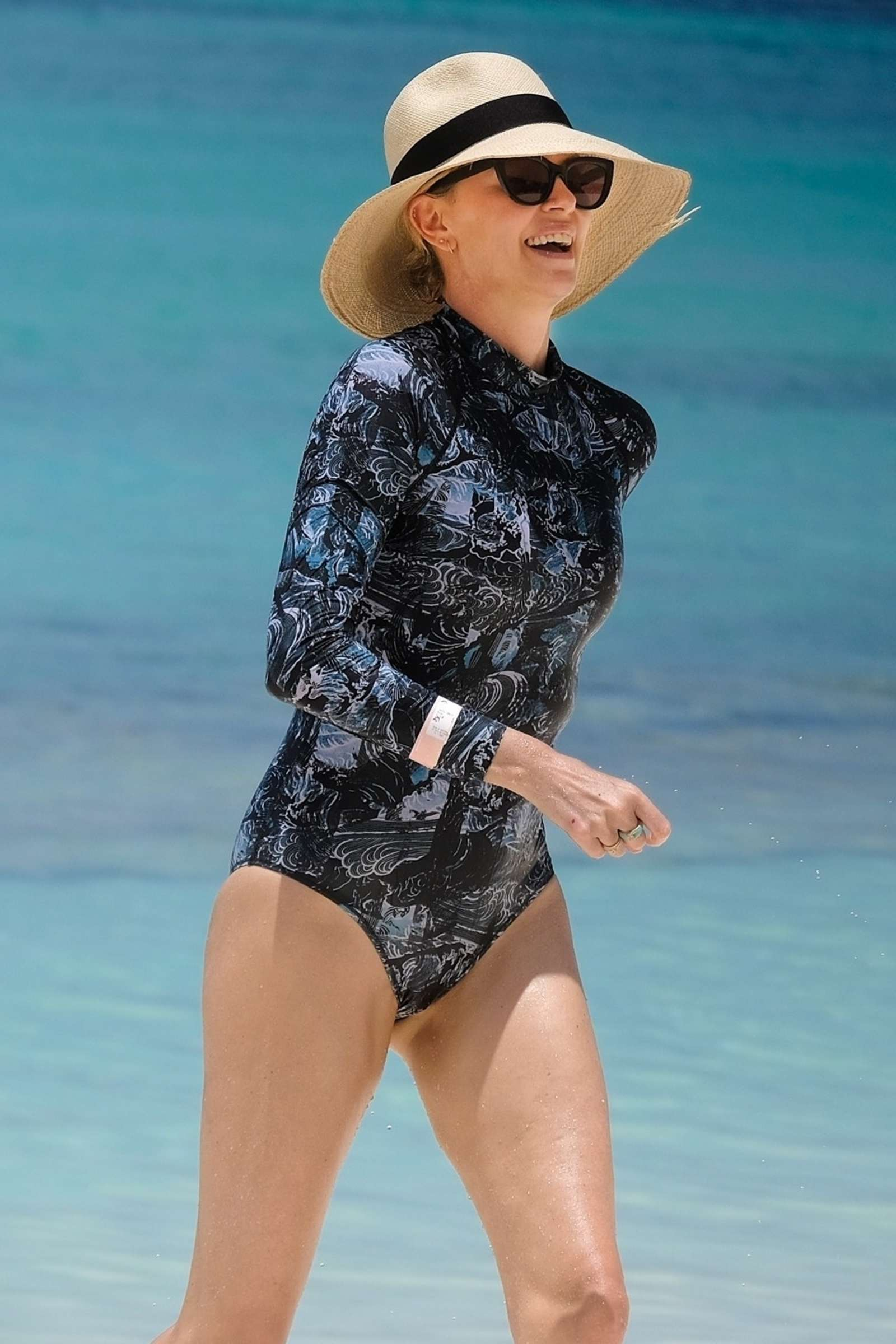 Charlize Theron in Swimsuit at the beach in Bahamas