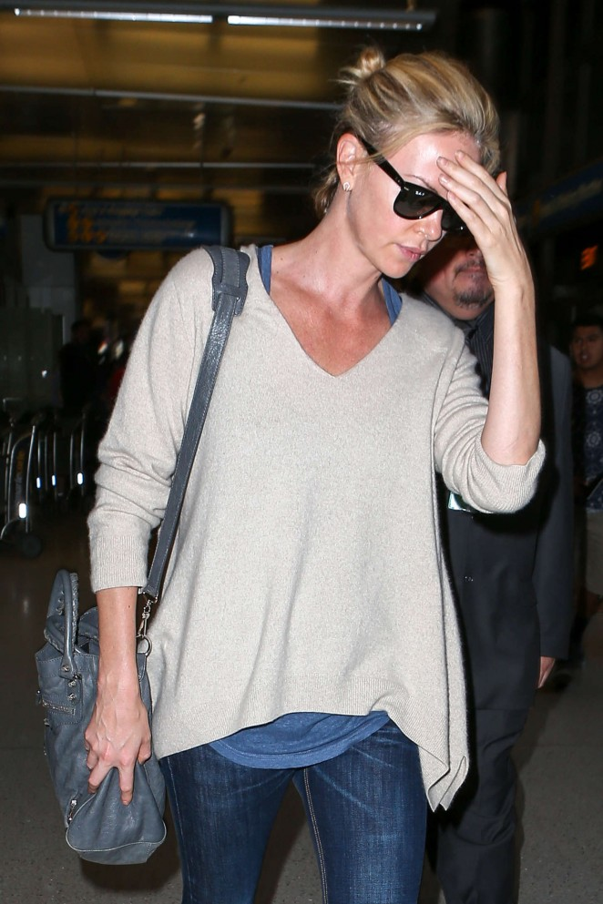 Charlize Theron in Jeans at LAX -01