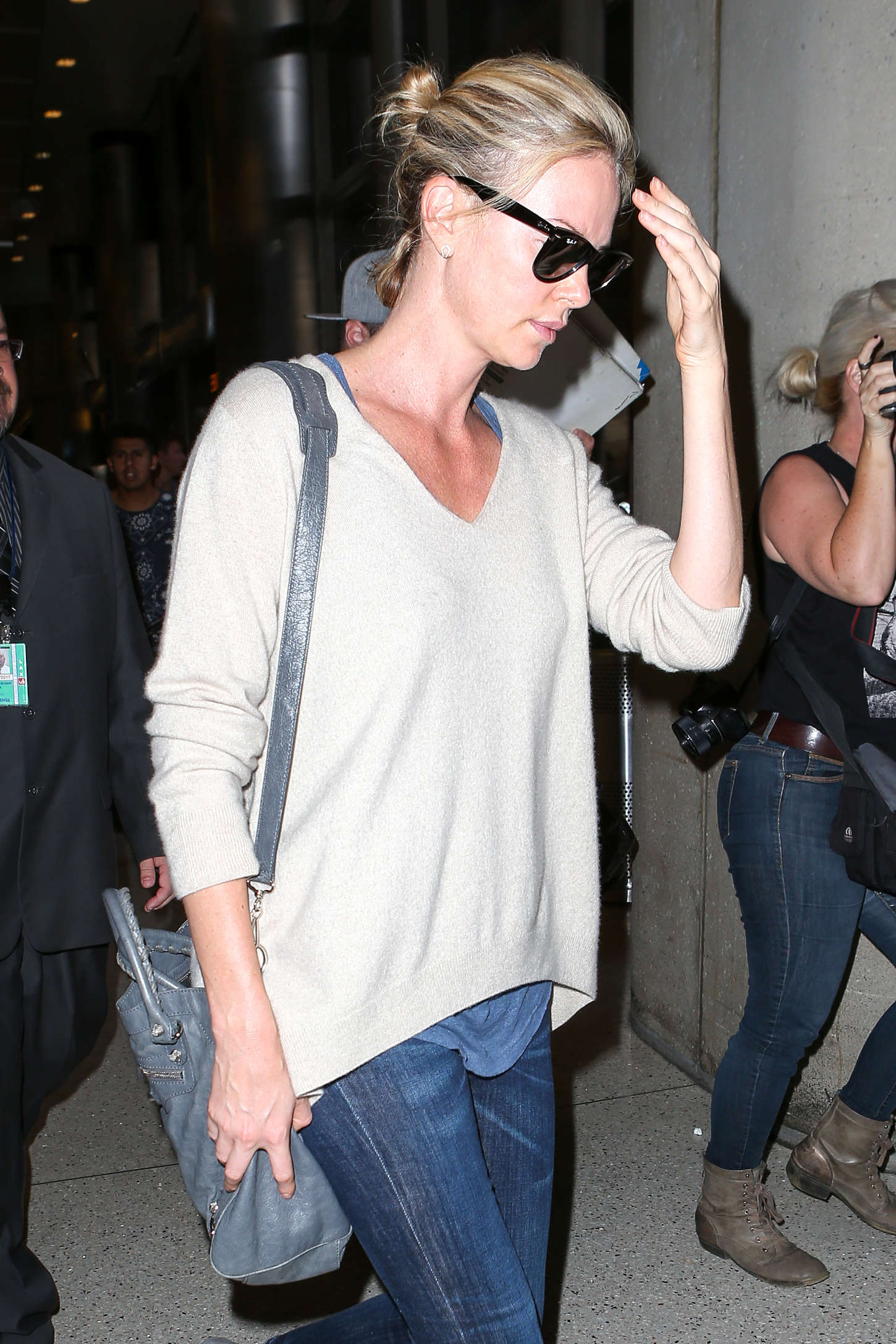 Charlize Theron in Jeans at LAX airport in LA