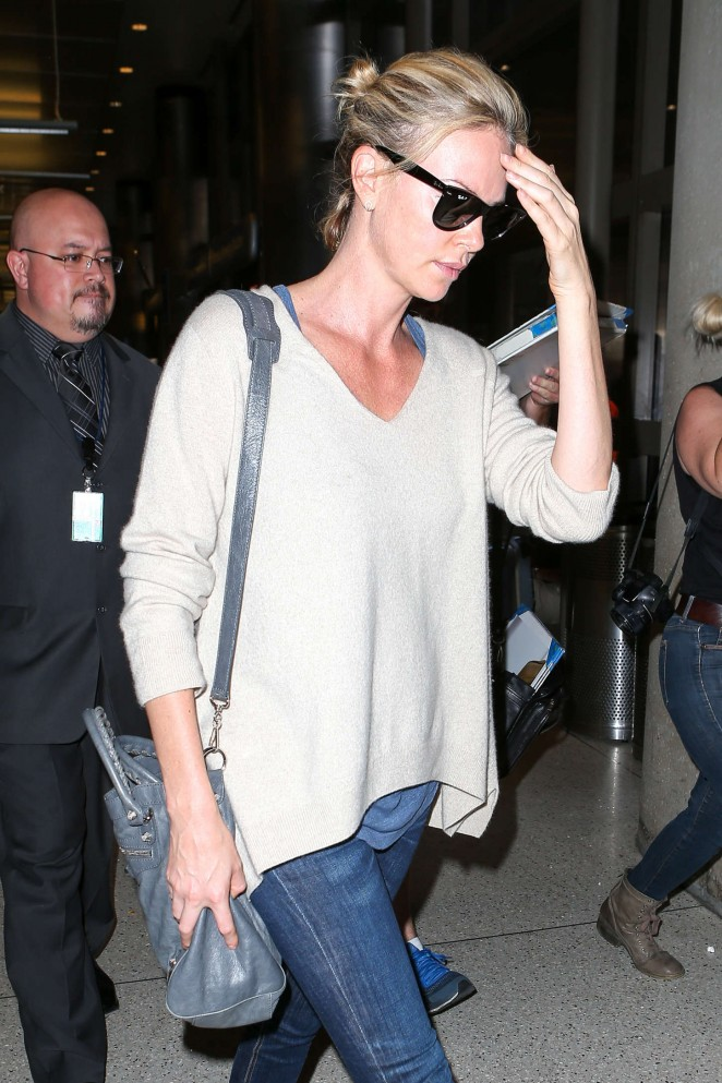 Charlize Theron in Jeans at LAX -05
