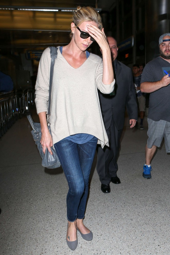Charlize Theron in Jeans at LAX -08