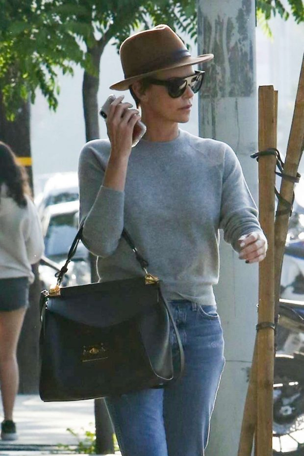 Charlize Theron - Leaves a salon in West Hollywood