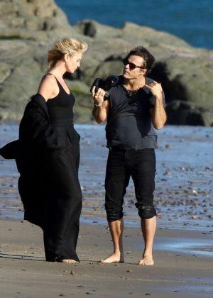 Charlize Theron on a Photoshoot in Malibu Beach