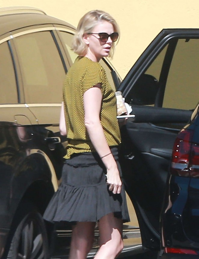 Charlize Theron in Mini Skirt out in LA