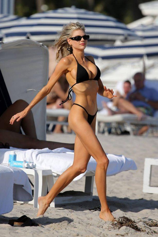 Charlotte McKinney - In a black string bikini at the beach in Miami