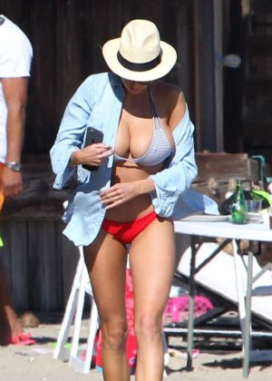 Charlotte McKinney in a red and blue bikini on the beach in Malibu