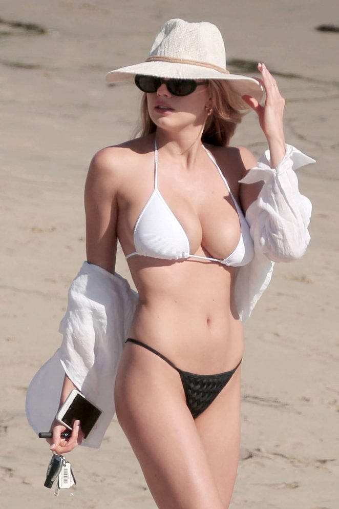 Charlotte McKinney in a tiny bikini at the beach in LA