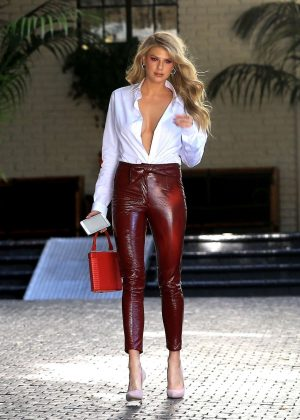 Charlotte McKinney - In red leather pants as she leaves the Chateau Marmont Hotel