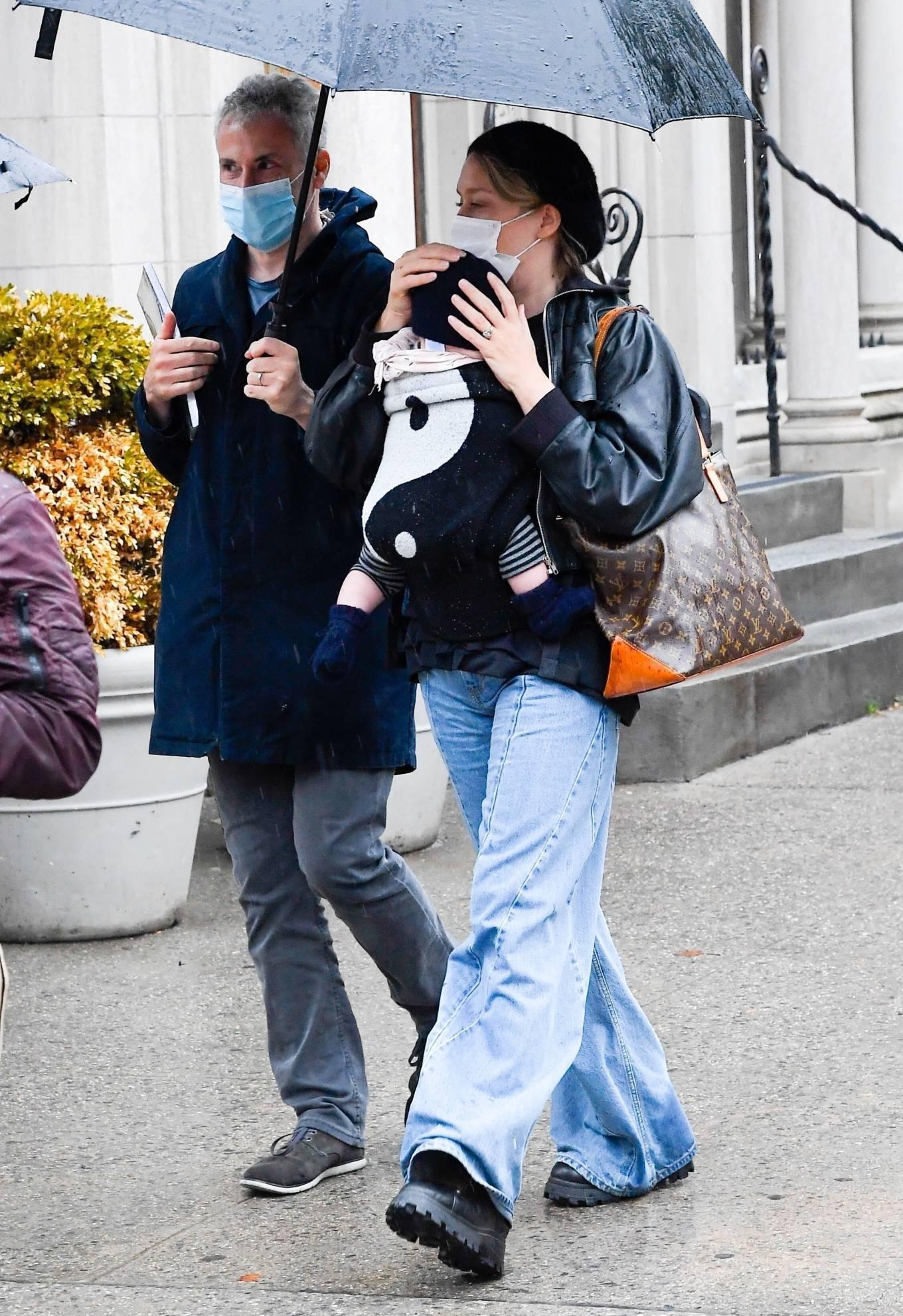 Chloë Sevigny - Cradles six-month-old baby boy Vanja in New York City
