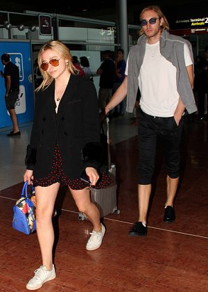 Chloe and Trevor Moretz - Arrive at Charles de Gaulle Airport in Paris