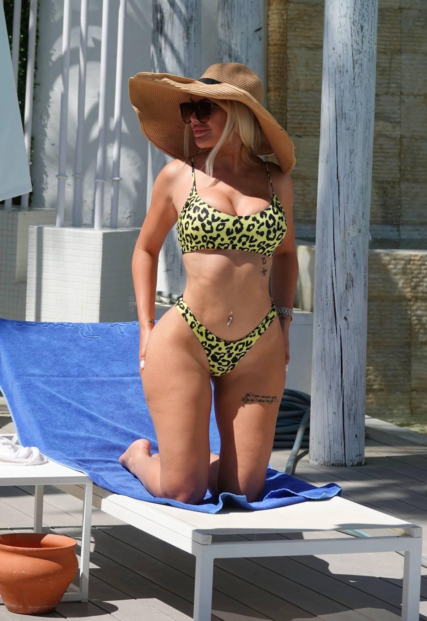 Chloe Ferry - In a bikini poolside on holiday in Marbella