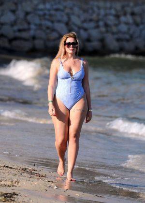 Chloe Ferry in Swwimsuit on the beach in Ibiza