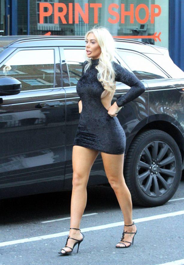 Chloe Ferry - Wearing a tight Little black dress in London