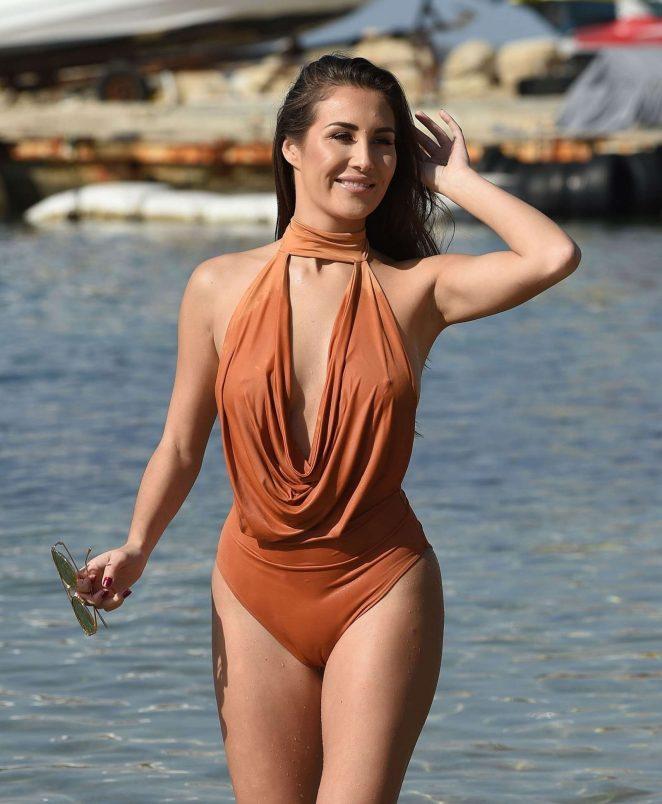 Chloe Goodman in Brown Swimsuit on the beach in Dubai