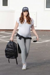 Chloe Goodman - Shows off her baby bump
