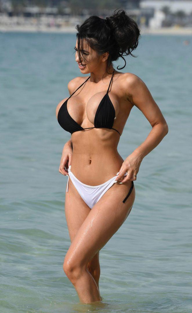 Chloe Khan in black and white bikini in Dubai