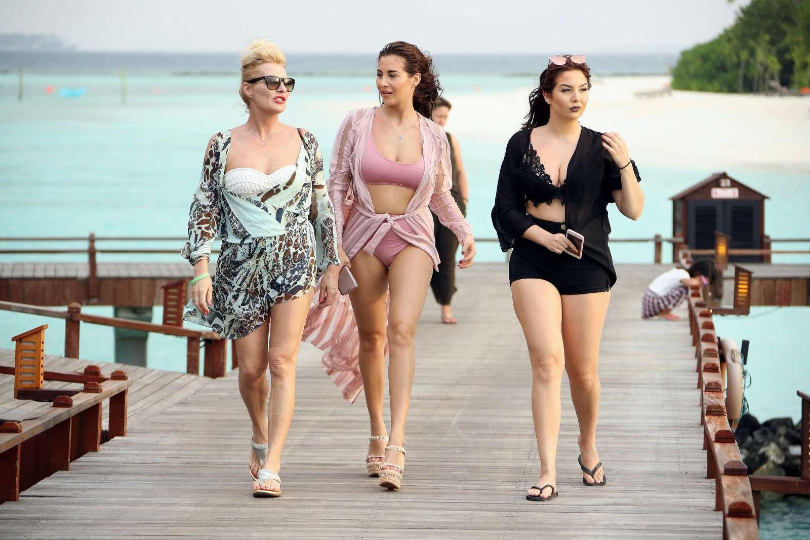 Chloe, Lauryn and Amelia Goodman on the beach in the Maldives