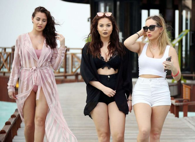 Chloe, Lauryn and Amelia Goodman on the beach in the Maldives