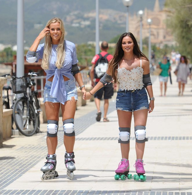Chloe Meadows and Courtney Green Rollerblading on the beach in Majorca