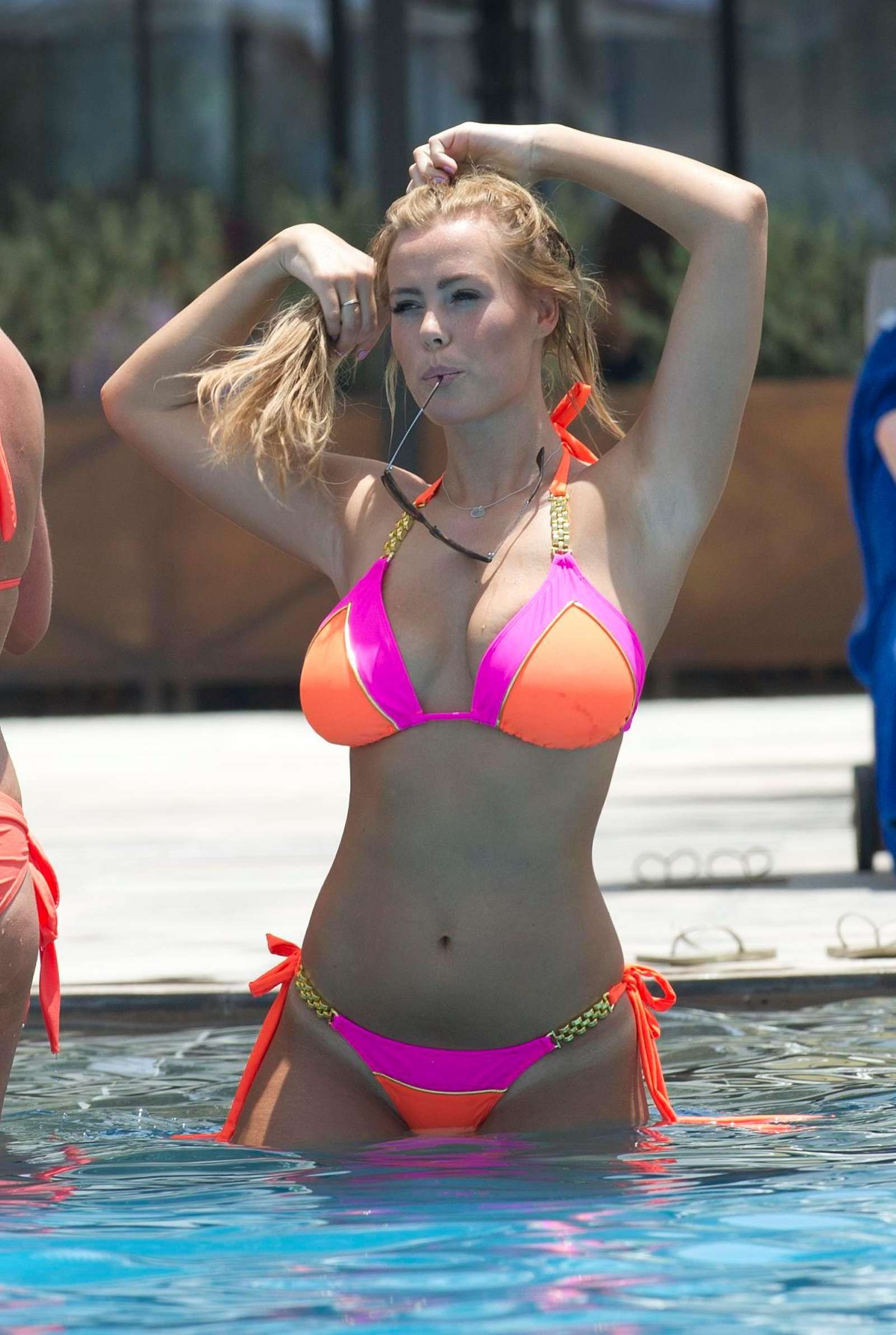 Chloe Meadows in Bikini at a pool in Dubai