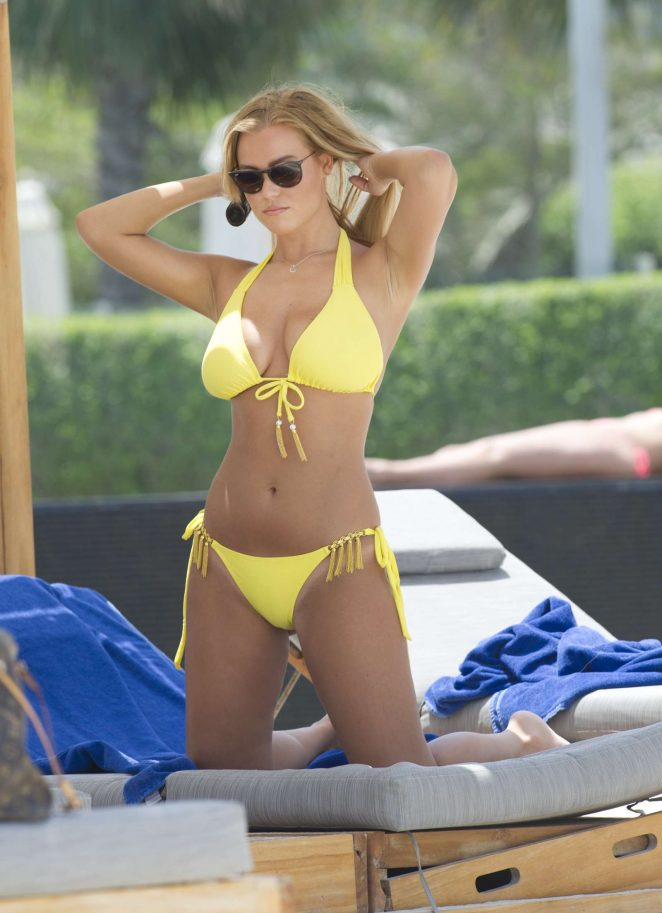 Chloe Meadows in Yellow Bikini on a beach in Dubai