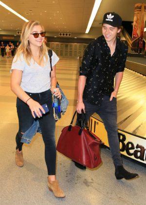 Chloe Moretz and Brooklyn Beckham at JFK Airport in New York