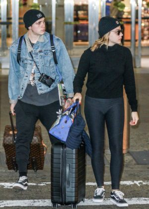 Chloe Moretz and Brooklyn Beckham at JFK Airport in NYC