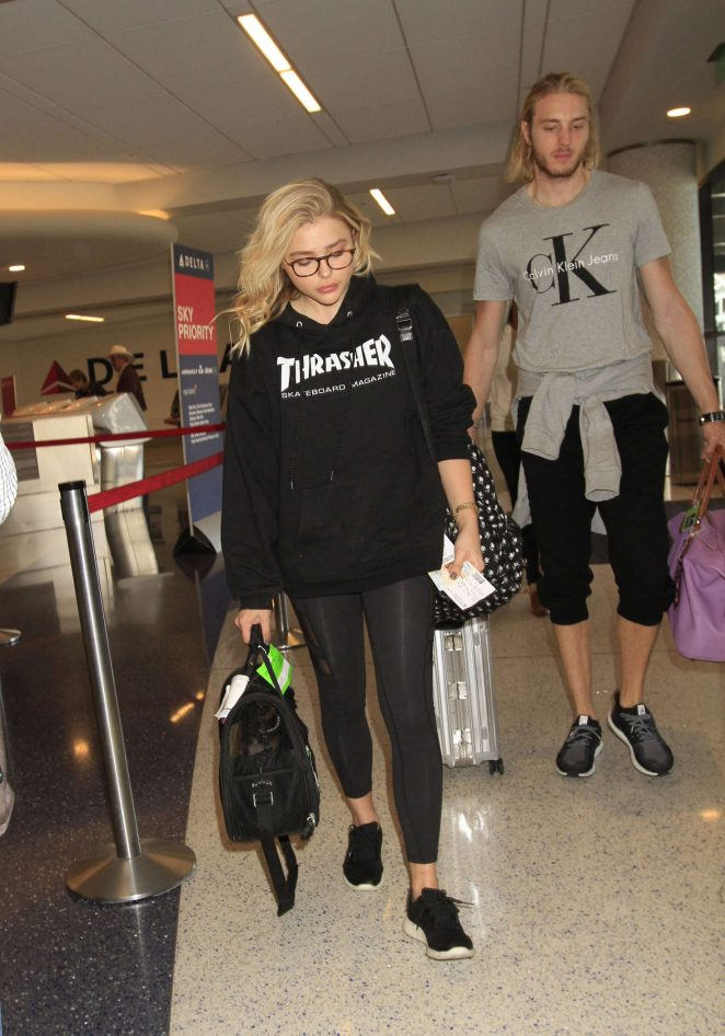 Chloe Moretz in Tights at LAX Airport in LA
