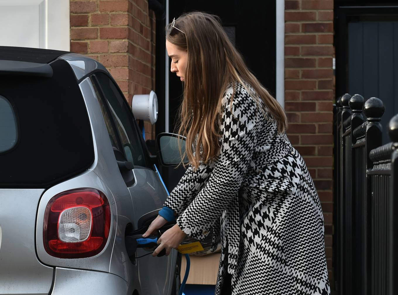 Chloe Ross - In her new electric smart car in Chigwell