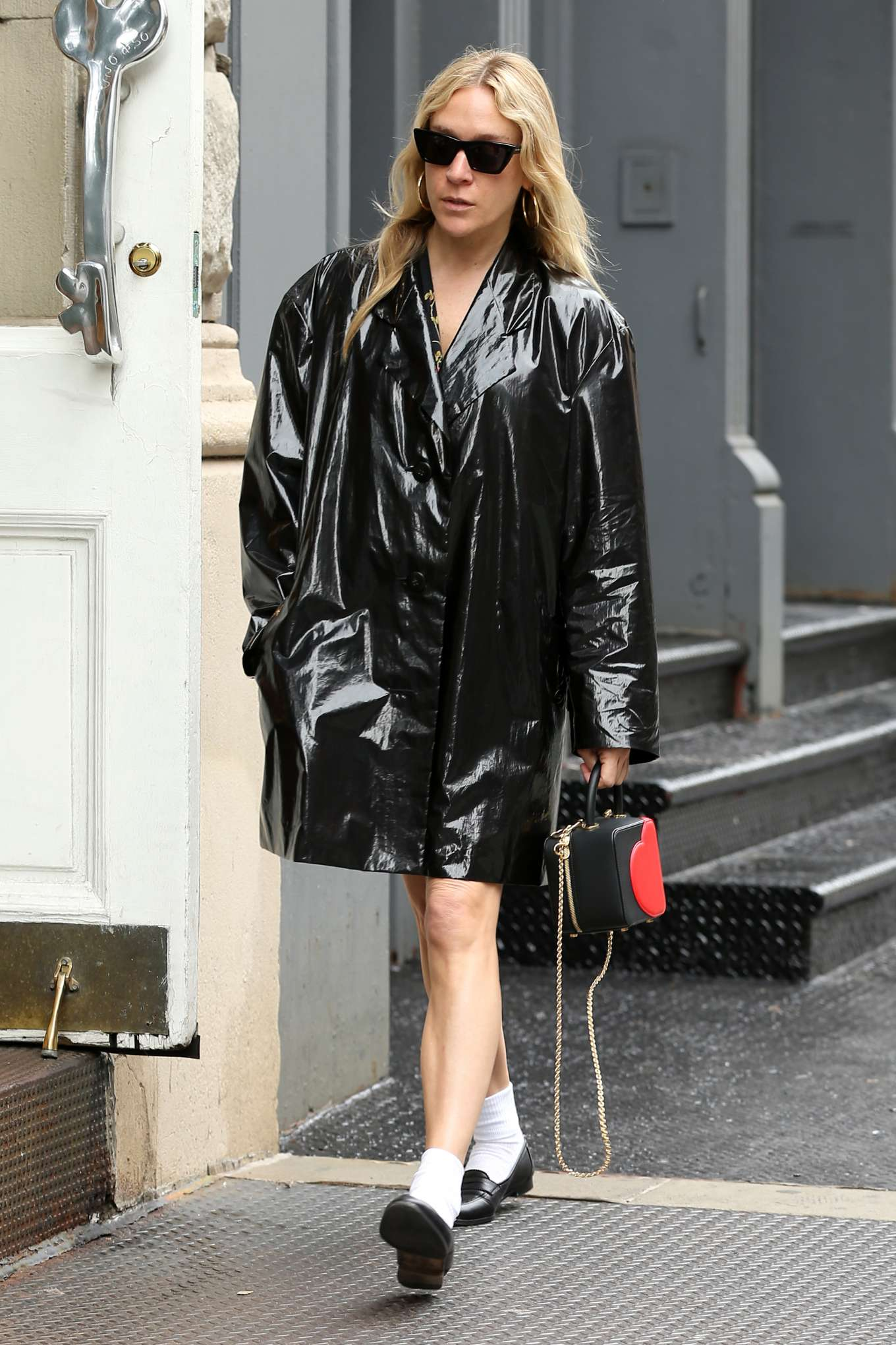 Chloe Sevigny in Black Coat at Olive's in New York