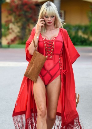 Chloe Sims in Red out in Marbella