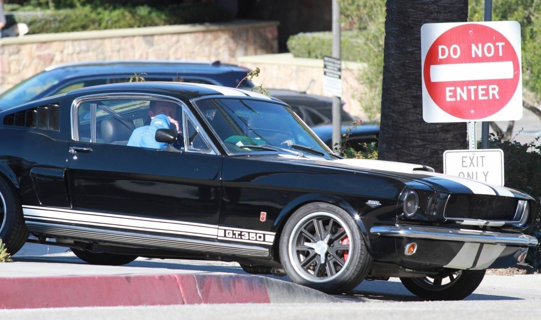 Chris Martin and Dakota Johnson - take her classic Mustang on a coffee run in Malibu