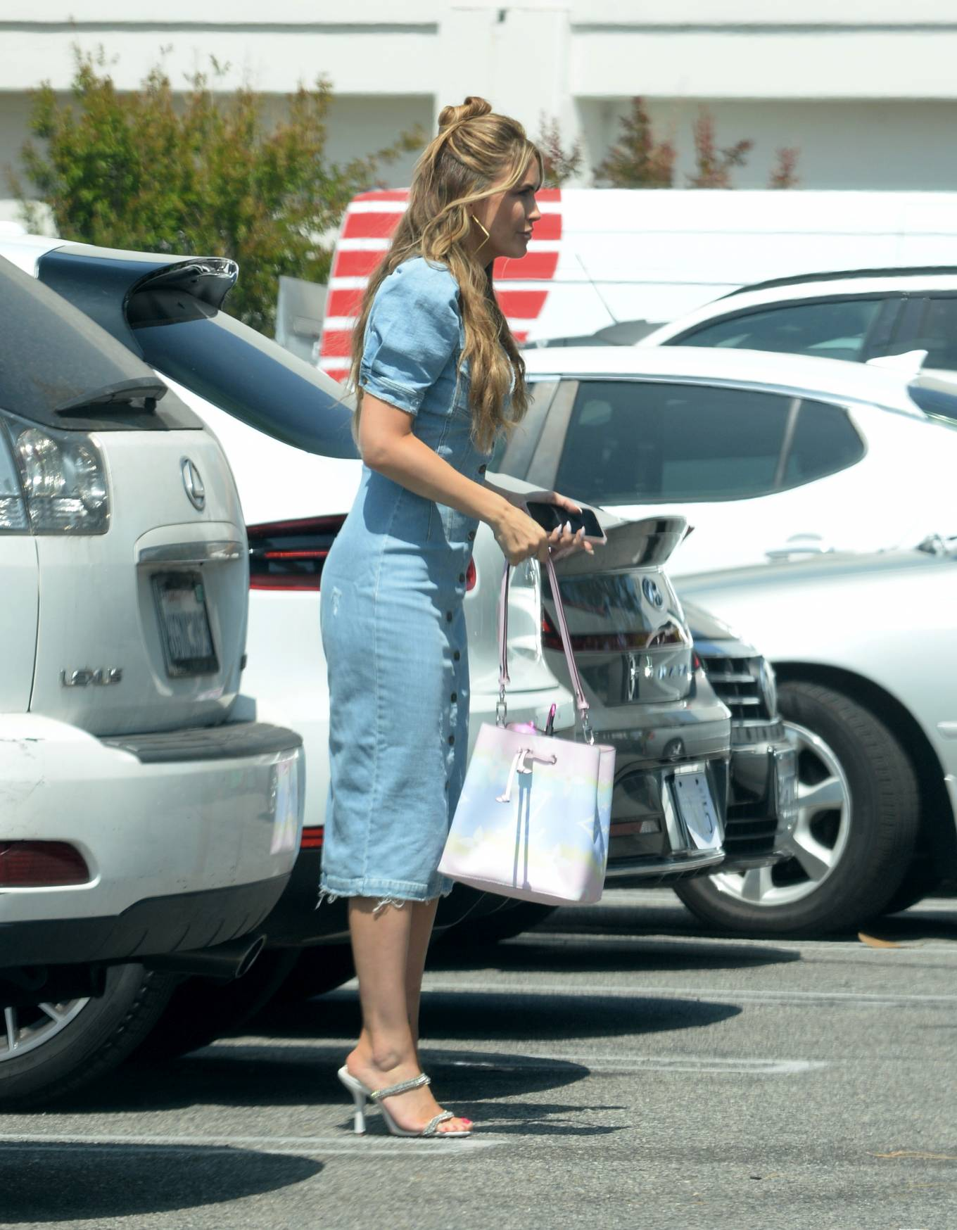 Chrishell Stause - Leaving her office in Los Angeles