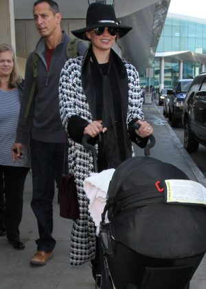Chrissy Teigen - Arrives at LAX Airport in LA