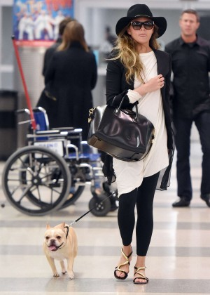 Chrissy Teigen - Arriving at JFK Airport in NYC