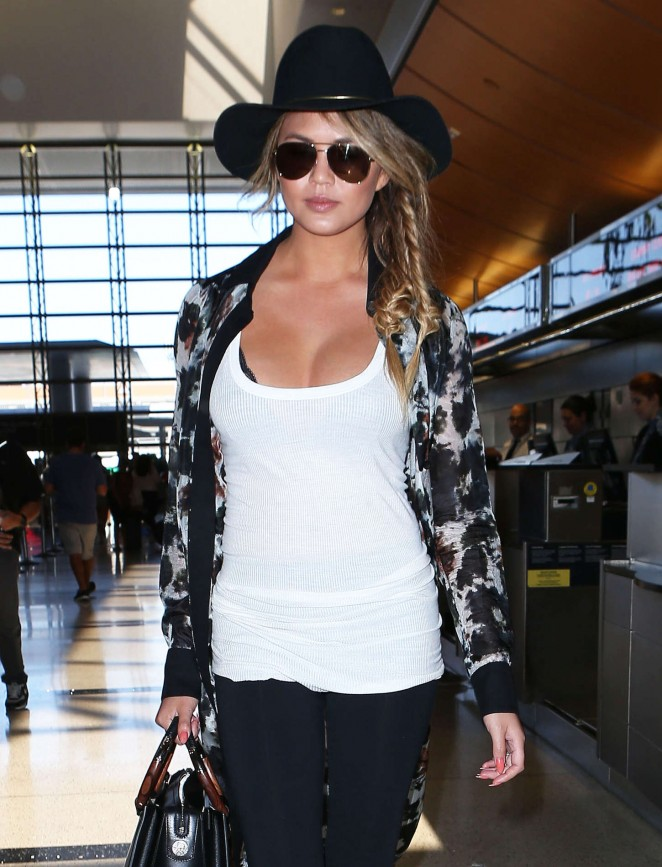 Chrissy Teigen - Arriving at Los Angeles International Airport