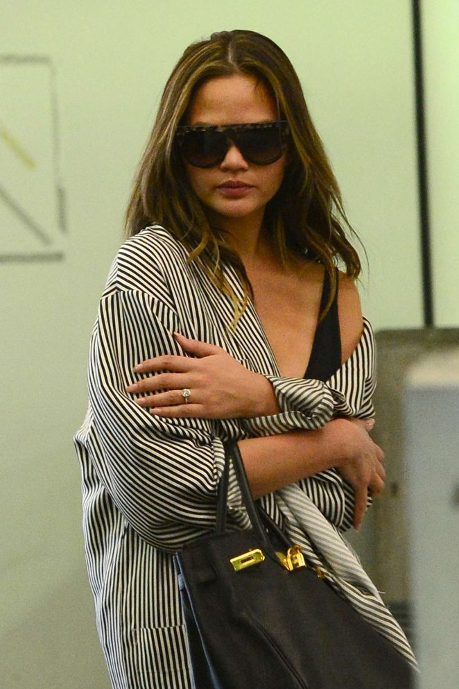 Chrissy Teigen Arriving at Miami Airport
