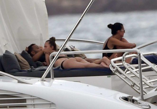 Chrissy Teigen - Bikini Candids on her yacht in Sardinia