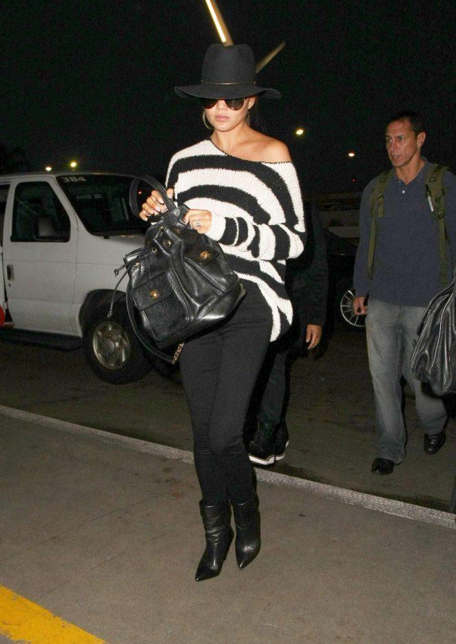 Chrissy Teigen in Black Pants at LAX Airport in LA